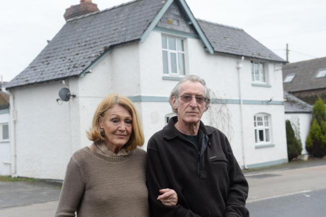 Charles and Susie Wilmott outside their home, the former Newtown Inn, in Lower Eggleton