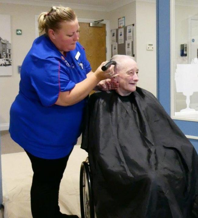 Liz Tame at Edwardstow Court gets her head shaved for charity