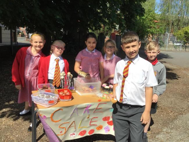 The children at from St Thomas Cantilupe C of E Primary during their charity cake sale