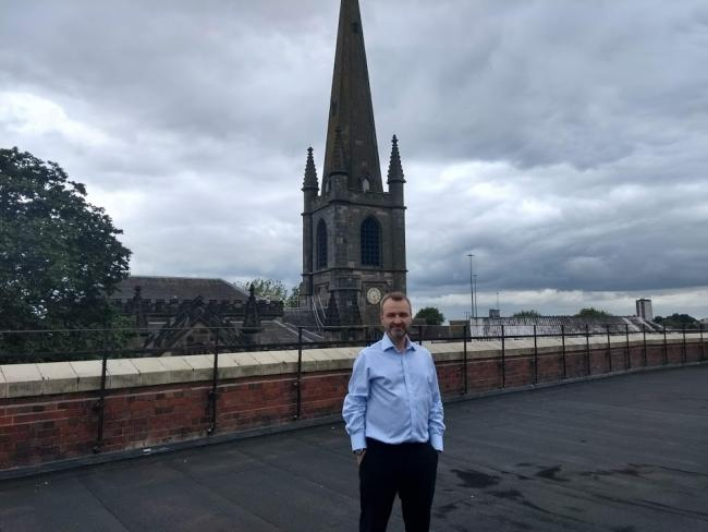 Marl Price, CEO of Loaves and Fishes, on the roof of Provision House on Dudley High Street.