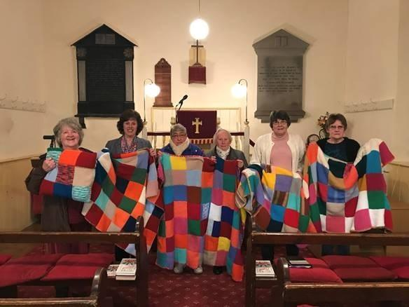 Members of the Creative Crafts Group with the blanket