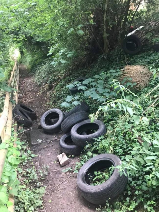 Several tyres were dumped on a path in Bromyard. Photo: Aaron Hughes.