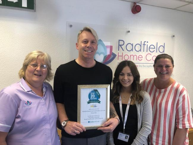 Staff from Radfield Home Care with their certificate after being named in the top providers in the West Midlands.