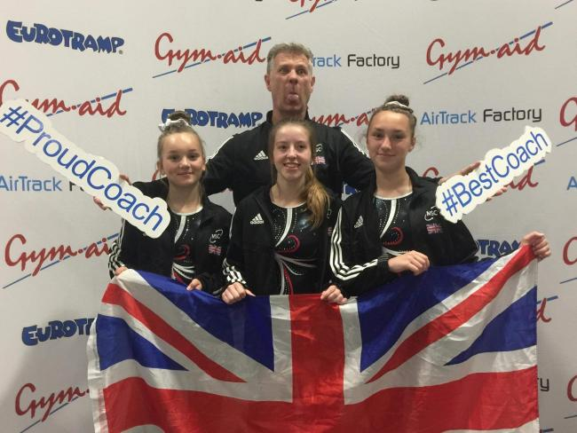 React Trampoline Club members Anna Preece, Lily Randall and Emily Pounder with coach Richard Crane