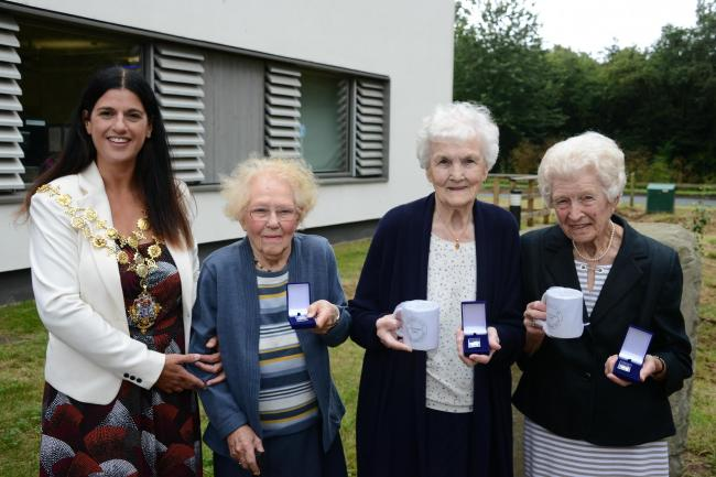 Vera Prisk, Dora Powell and Alice Herring receive their badges from Hereford Mayor, Councillor Kath Hey