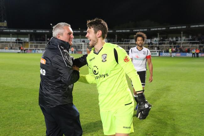 Tim Harris congratulates goalkeeper Brandon Hall following Tuesday night's 1-0 victory. Picture: Steve Niblett/Hereford FC