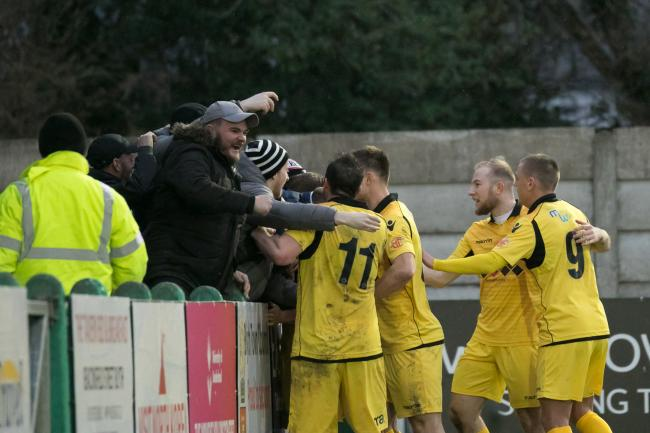Hereford fans celebrating during the 3-2 win at Blyth Spartans last season. Picture: Andy Walkden