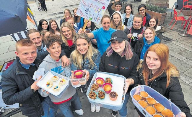 GROUP: Young people on the National Citizen Service programme, handing out free cakes and positive messages to people