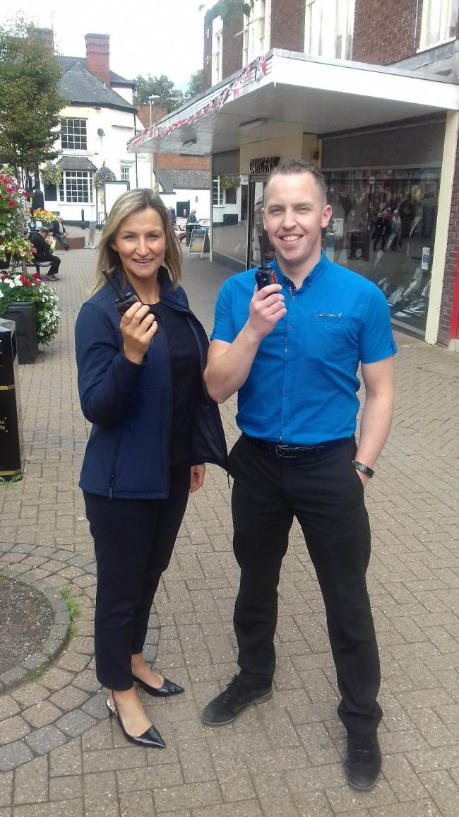 BID manager Vicky Rogers with Dave Dancer, of Dancers, with the new walkie talkies.