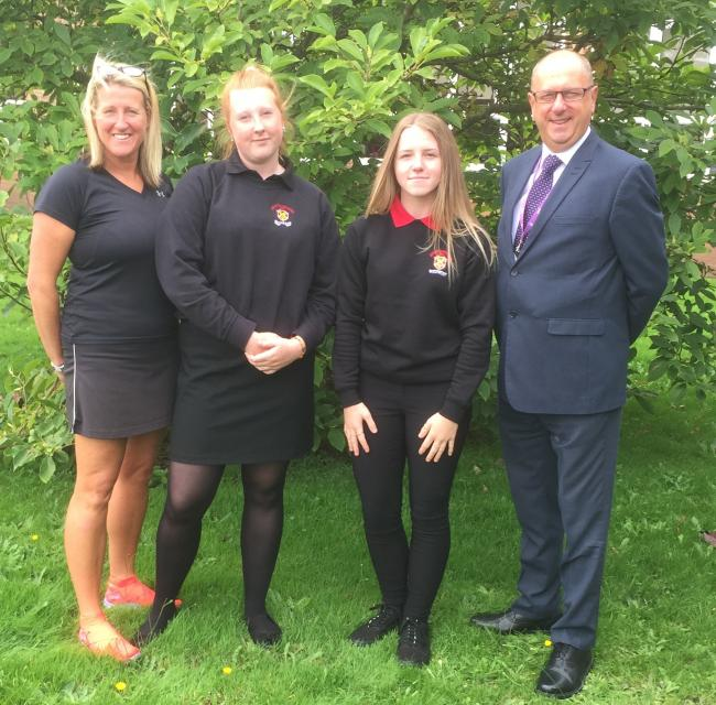 Poppy Godwin and Ellie Murrell with representatives from John Kyrle High School