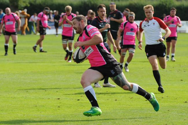 Drew Cheshire scores during last year's Lucs in Pink match