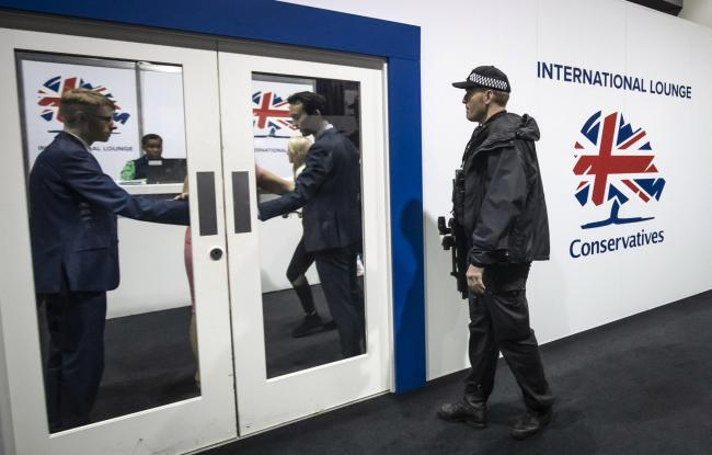 LOCKDOWN: Police arriving at the Conservative Party conference (Danny Lawson/PA)