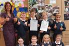 Thumbs up from Headteacher Sarah Groves and pupils after their inspection report