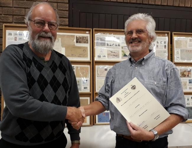 Jim Etherington receiving his certificate from society member John Setchfield