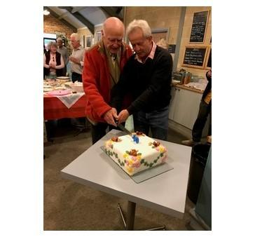 Ebrington Gardening Club founder chairman Peter Satterthwaite and current president Pete Drinkwater cutting the 40th anniversary cake
