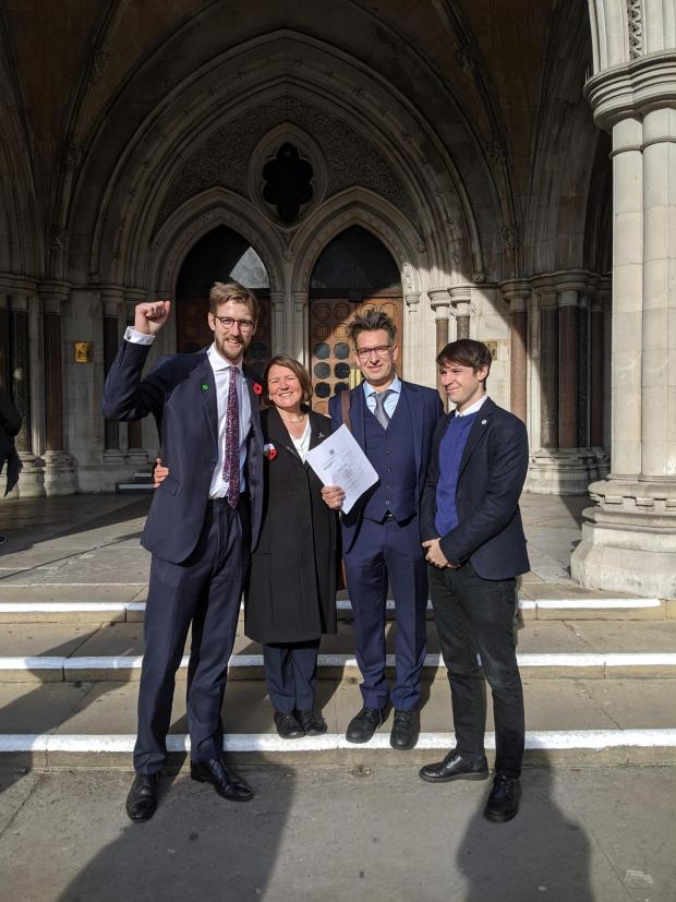 Hereford Times: Ellie Chowns (second from left) celebrating after the High Court ruling