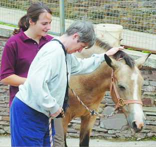 One of the guests at Barton Hill Centre enjoying getting to know the pony a little better.