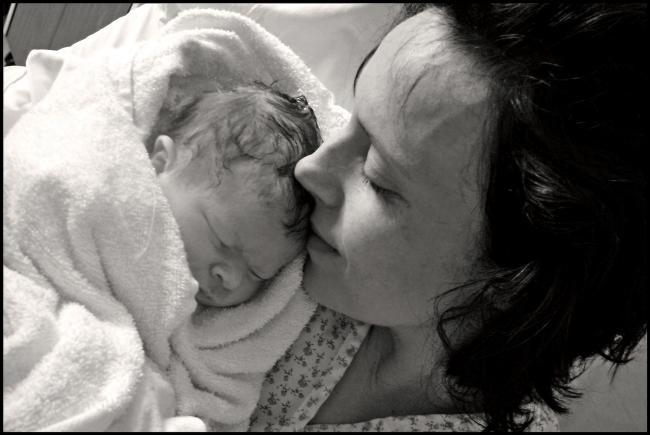 Rhiannon Davies with the couple's daughter Kate Stanton-Davies, who tragically died hours after birth.