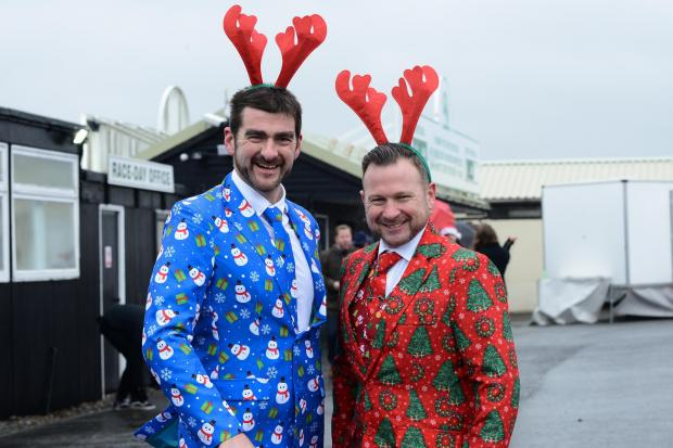 Christmas Jumper Raceday at Hereford Racecourse - Adam Huselbee & Mike Robinson sporting Christmas suits..