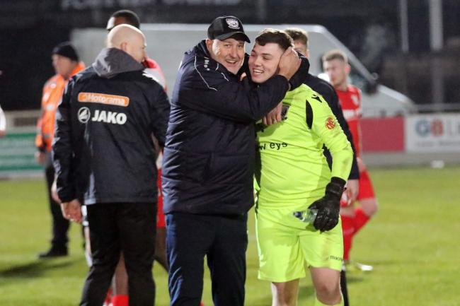 Russell Slade celebrates the win with goalkeeper Brandon Powell. Picture: Steve Niblett/Hereford FC