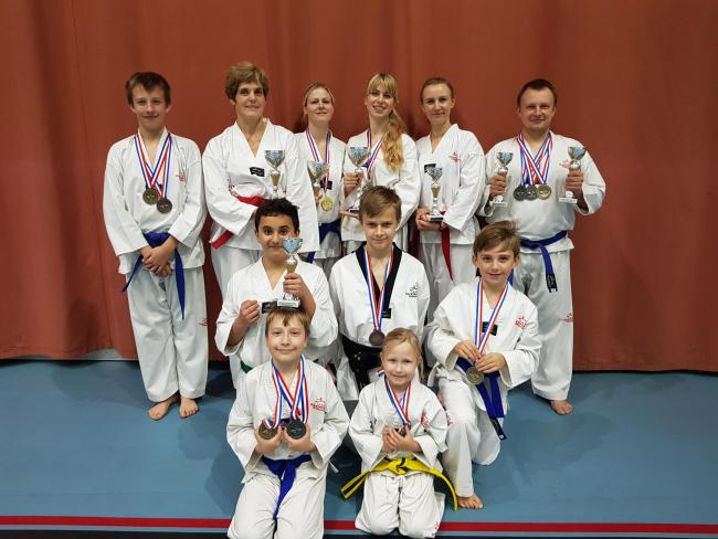Hereford Taekwondo medal winners: (back row) Patryk Janczewski, Julie Hadley, Kelly Marshall, Maria Poranski, Laura Rackauske, Adam Janczewski. Middle row: Ed Mocanu, Oskaras Rackauskas, Stefan Dragomir. Front row: Daniel Janczewski, Nikola Janczewska