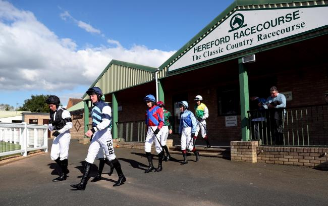 "Jockeys leave the weighing room for the bet365/British Stallion Studs EBF ""National Hunt"" Novices' Hurdle during the Bet365 Opening Raceday at Hereford Racecourse."