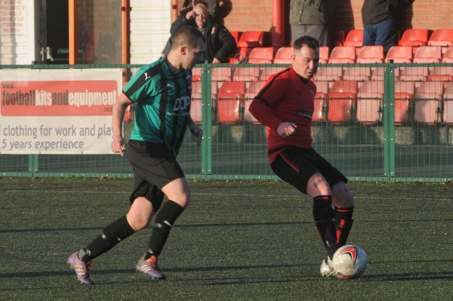 Ludlow Colts forward Simon Bradley passes in the match against Fownhope.