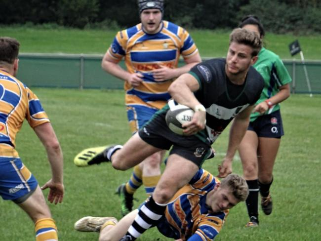 Tom Assal looks to make an offload for Ledbury. Picture: Jackie Humphreys