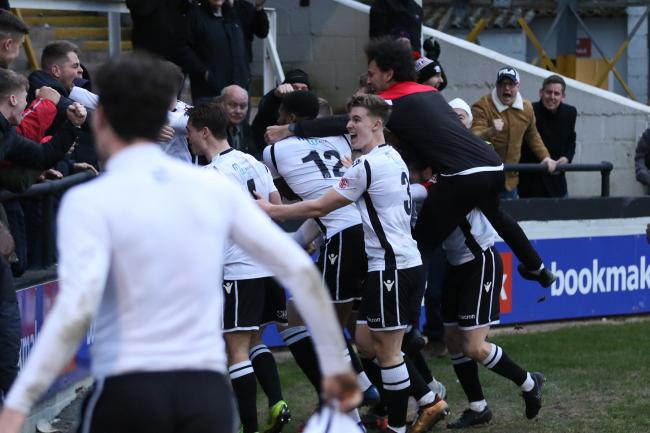 Interim manager Josh Gowling celebrates the equaliser with his players. Picture: Steve Niblett/Hereford FC