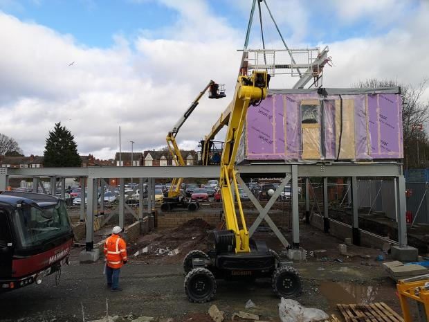 Hereford Times: The first section of the student accommodation block being lifted into place at the Station Approach site in Hereford in February 2020. Picture: Malcolm Hince