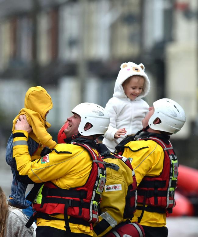 Rescue operations continue as emergency services take families to safety, after flooding in Nantgarw, Wales as Storm Dennis hit the UK. Picture: Ben Birchall/PA