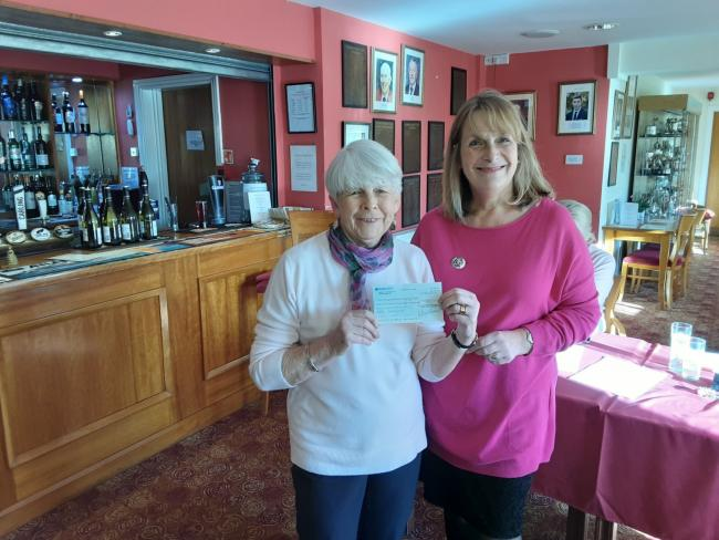 Lesley Kewley, left, receives a cheque for £1,006 from retiring captain of Evesham Golf Club ladies Lesley Curnock