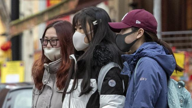 Members of the public wearing face masks amid coronovirus fears