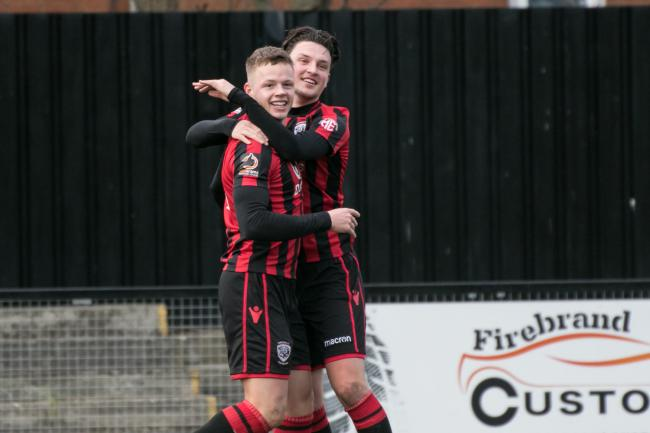 Kelsey Mooney celebrates his goal at Farsley Celtic with Tom Owen-Evans. Picture: Andy Walkden/Hereford FC