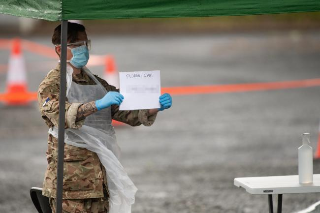 Army personnel at the mobile coronavirus testing centre at Hereford's Merton Meadow car park. Picture: Jacob King/PA Wire