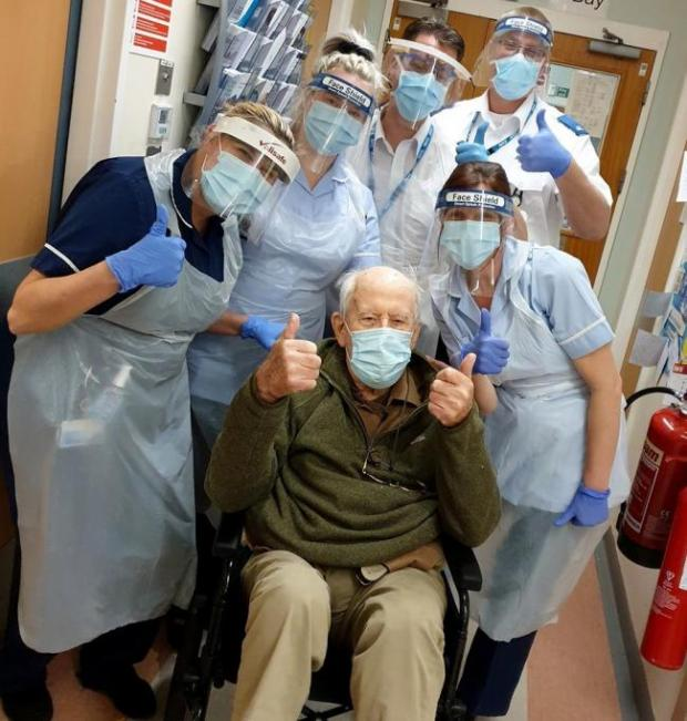 Hereford Times: Coronavirus survivor 101-year-old Keith with staff at Ward 12 at Alexandra Hospital in Redditch