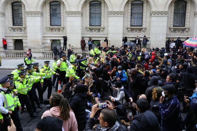 Police clash with protesters during a Black Lives Matter protest rally in London in memory of George Floyd on Sunday June 7. Picture: Aaron Chown/PA Wire