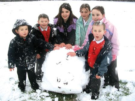 Children enjoy the snow at Withington Primary School.