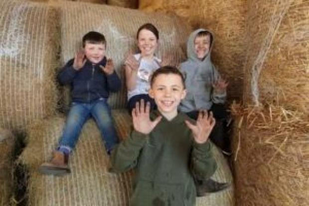 Ava and Cameron Heath, aged 9, have got stuck in with the clearing ofthe woodland, Reagan Heath, aged 7, rolled his sleeves up and got stuck in with the relaying of the bark paths and Rocco Heath, aged 4, didn't let age stop him and proved that he