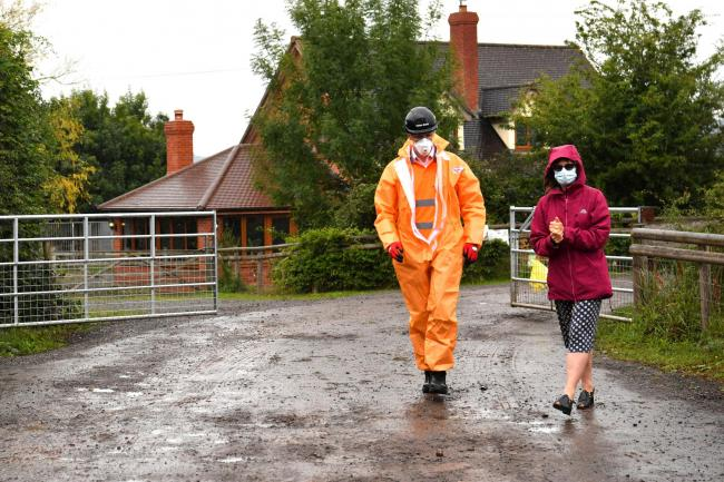 Karen Wright , right,  Director of Public Health for Herefordshire CCG,  at the farm. Picture: Ben Birchall/PA Wire
