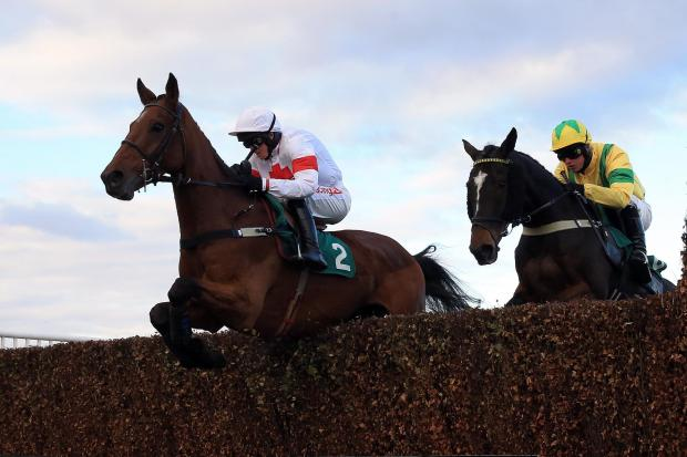 Minellacelebration (left) ridden by Ben Postle clears a hurdle to win the Molson Coors Interactive Steeple Chase ahaed of Dr Robin ridden by Sean Bowen (right) at the Family Raceday at Aintree Racecourse. PRESS ASSOCIATION Photo. Picture date: Sunday Octo