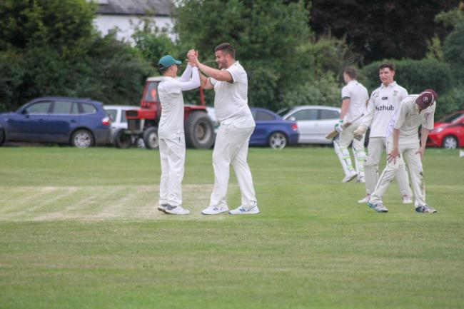 Alex Rowley (Left) celebrating with team mate after his wicket. Picture: Sean Arrowsmith