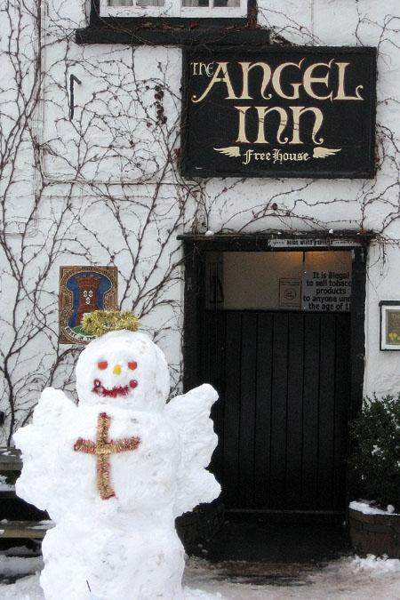 A snow angel outside The Angel Inn, Grosmont.