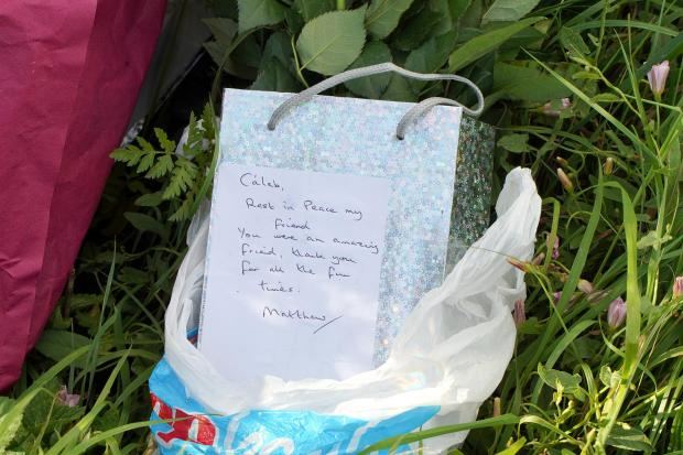 Hereford Times: Tributes to the pair were left at the scene after the crash in July 2020. Picture: Rob Davies