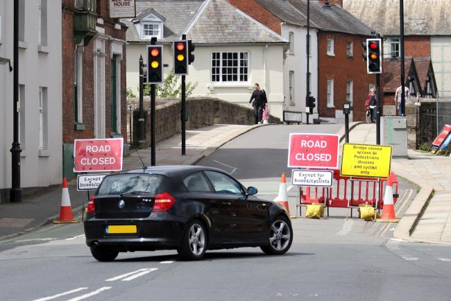 A car turns around on Bridge Street due to the road closures. Picture: Rob Davies