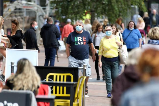Shoppers in High Town, Hereford, as Government makes it compulsory to wear face coverings in shops.
