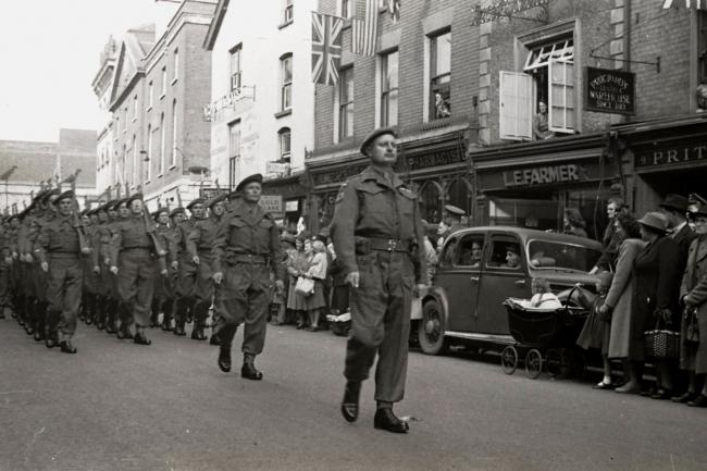 The 1st Battalion, the Herefordshire Regiment, exercises its right to march through Hereford in Broad Street on September 29, 1945