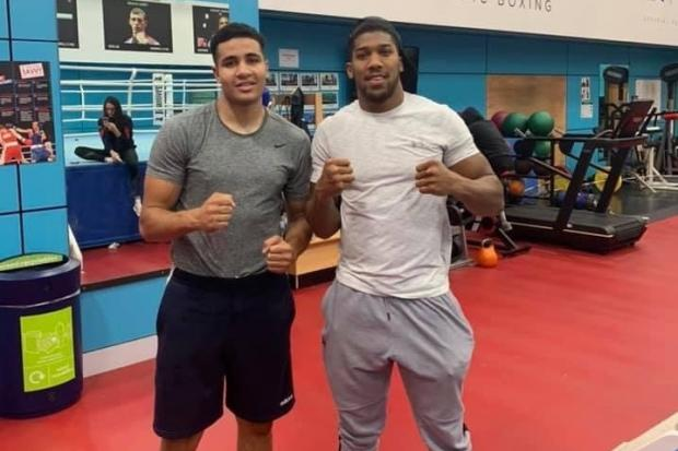 Delicious Orie with professional boxer Anthony Joshua in Sheffield on Team GB