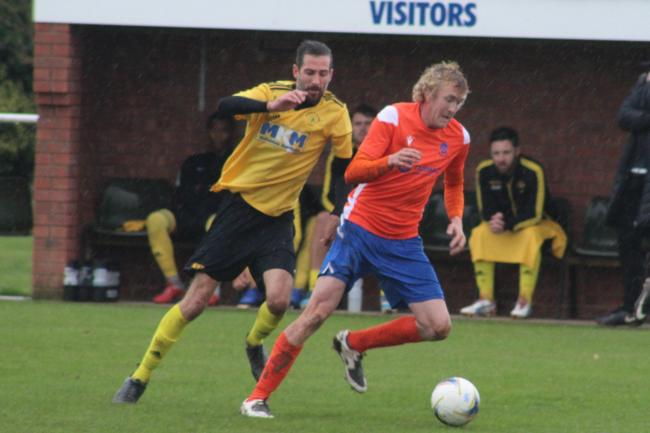Saul Thomas scored for Wellington in their 2-1 home defeat to Newent Town. Picture: Barcud-Coch Photography