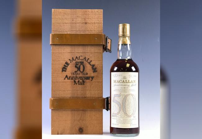 This bottle of Macallan 50-year-old malt whisky bought for £80 has been sold for £69,817